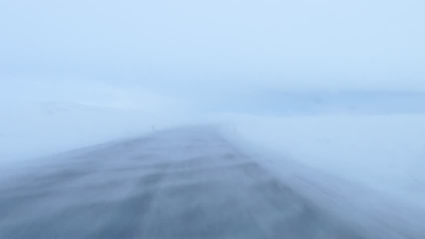 Driving a car through blizzard snowstorm in Iceland. (pov)