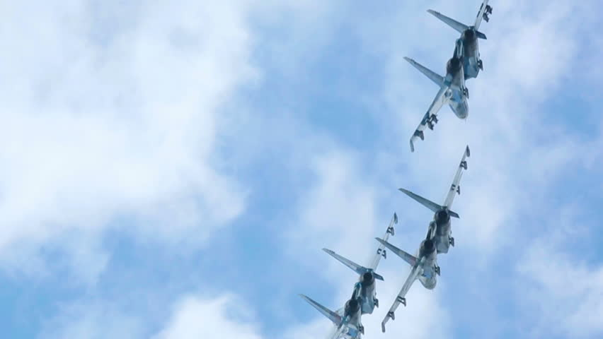NOVOSIBIRSK, RUSSIA - JULY 28, 2013: Sukhoi Su-27 jet fighters performing group aerobatics, celebration of Aviator's day airshow on July 28, 2013 in Mochishe airdrome, Novosibirsk, Russia.