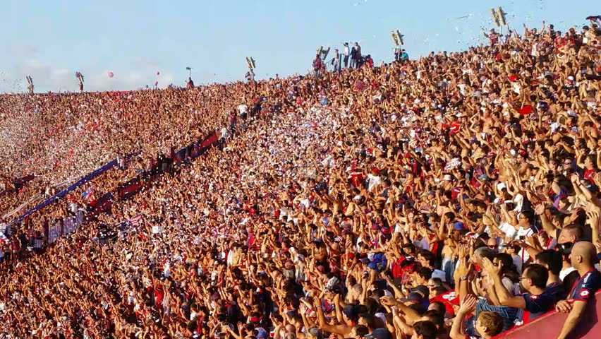 BUENOS AIRES, ARGENTINA - MARCH 15: Argentine soccer audience in stadium watching soccer match between the teams of San Lorenzo and Huracan on 15th march 2015 singing song