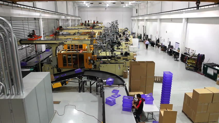 A wide shot time lapse of an entire robotics assembly plant in motion.  - HD stock video clip