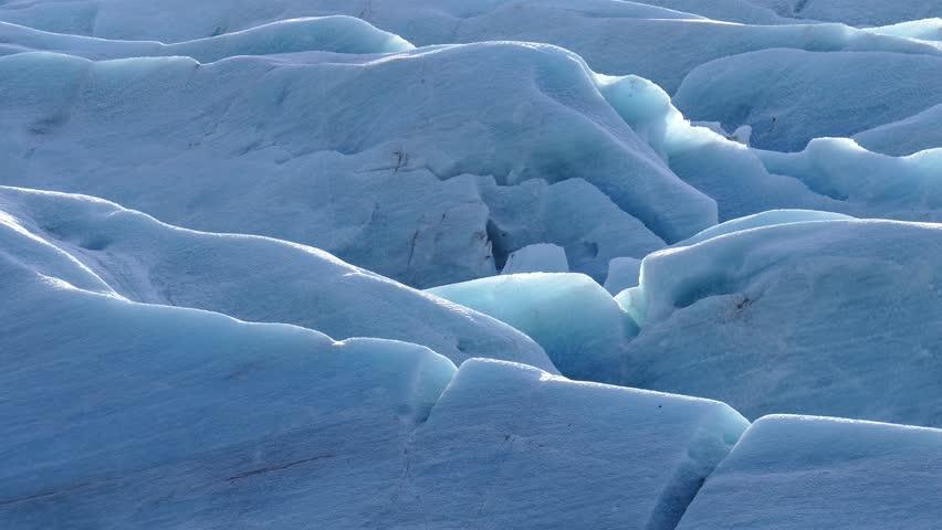 Blue Ice of Svinafellsjokull glacier, Skaftafell National Park, a part of the larger Vatnajokull National Park, South of Iceland - 4K stock footage clip