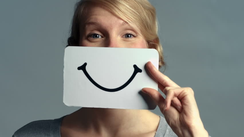 Woman showing her Emotions Using A piece of Cardboard | Shutterstock HD Video #9454589