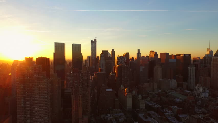 New York City Aerial v85 Flying low over West Side Manhattan buildings towards Midtown at sunrise. 3/13/15