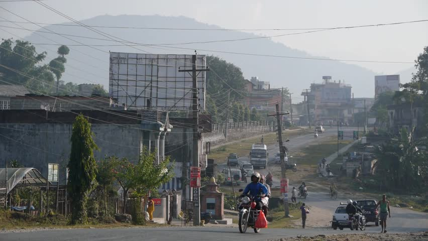 Pokhara,Nepal - October 23,2012: Street on hill with traffic in Pokhara - HD stock video clip