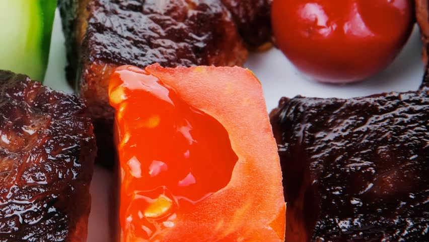 european food: grilled beef meat china plate with olives and tomatoes 1920x1080 intro motion slow hidef hd - HD stock footage clip