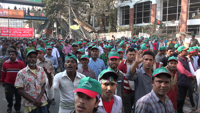 DHAKA, BANGLADESH - 16 DECEMBER 2014: People walk through the streets celebrating Victory Day in Dhaka. Victory Day marks the end of a war between what are now Pakistan and Bangladesh. - 4K stock footage clip