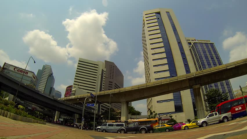 BANGKOK - March 2015: Bangkok's traffic with BTS sky trains passing by. Silom - HD stock footage clip