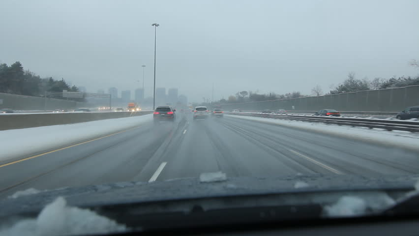 TORONTO, CANADA – JANUARY 4th: Winter drive on Highway 401 in Toronto, Canada on January 4th, 2015. The part of Highway 401 that passes through Toronto is the busiest highway in the world. - HD stock footage clip