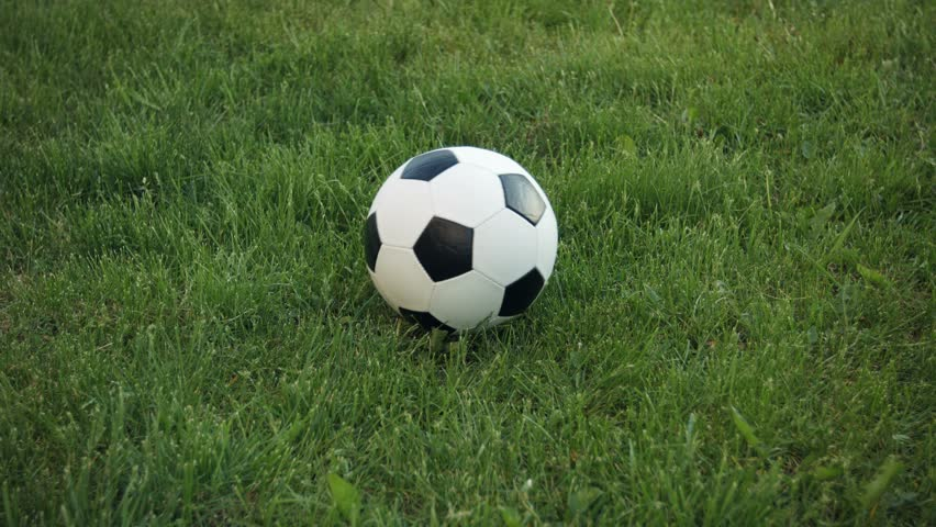Video 3840x2160 - Soccer Ball Spinning On The Field With ... Rolling Soccer Ball