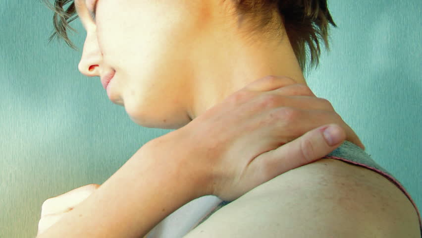 Girl massages her neck - HD stock footage clip