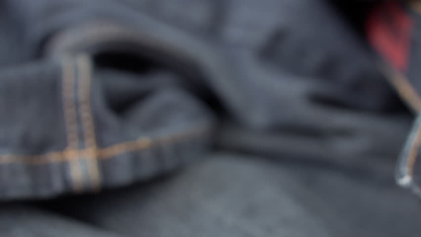 Blue denim jeans close up HD stock footage. A close up dolly shot of blue denim material filmed on the Blackmagic Cinema Camera. ProRes 422