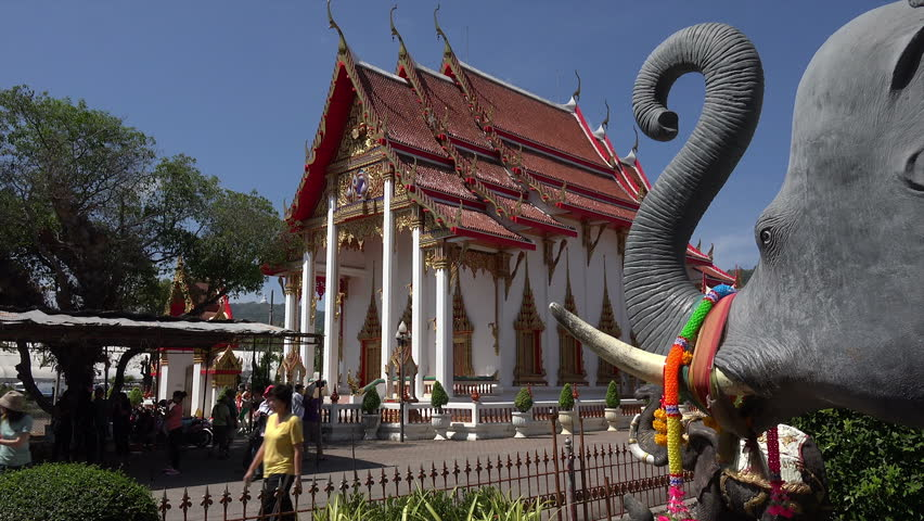 PHUKET, PHUKET ISLAND/THAILAND - FEBRUARY 05, 2015: Unidentified tourists visit Buddhist temple of Wat Chalong. This temple is the most important of the 29buddhist templesofPhuket. - HD stock footage clip