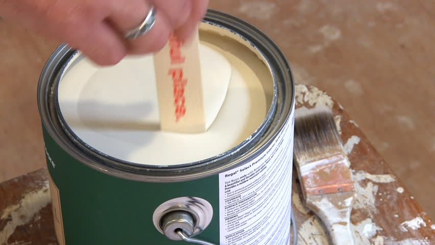 Lid is removed from full paint can and then paint is stirred with stick - HD stock footage clip