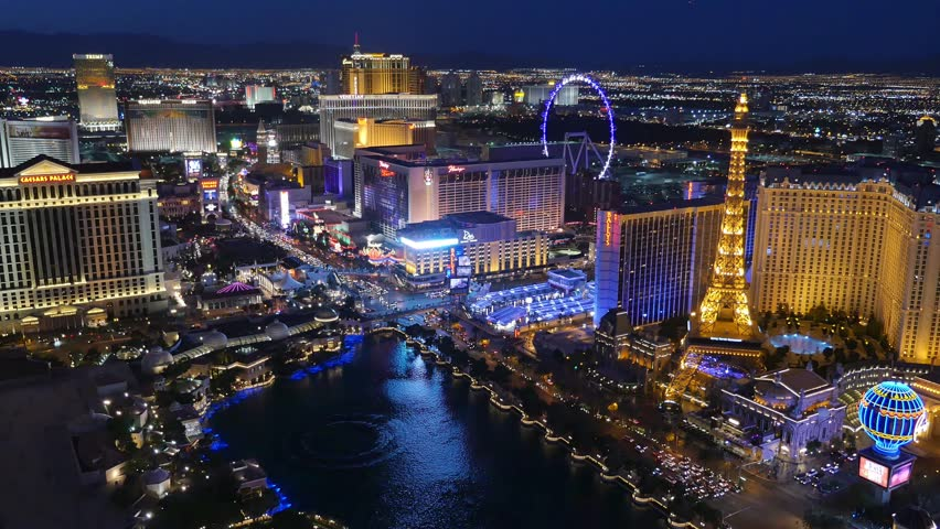 LAS VEGAS, Circa April, 2015 - A unique night aerial establishing shot of the Las Vegas Strip with the Bellagio fountains in the foreground. | Shutterstock HD Video #9621620