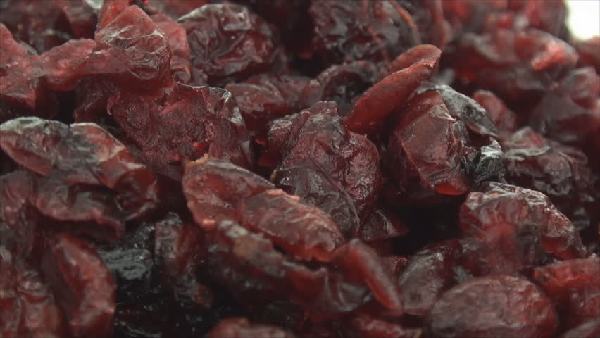 Zoom out of dried cranberries on white background 2. This video was shoot using custom light set up with additional custom build underneath light system to eliminate shadows. - HD stock video clip