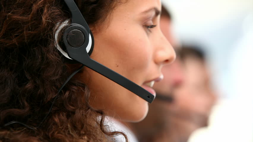Woman talking on the headset in an office