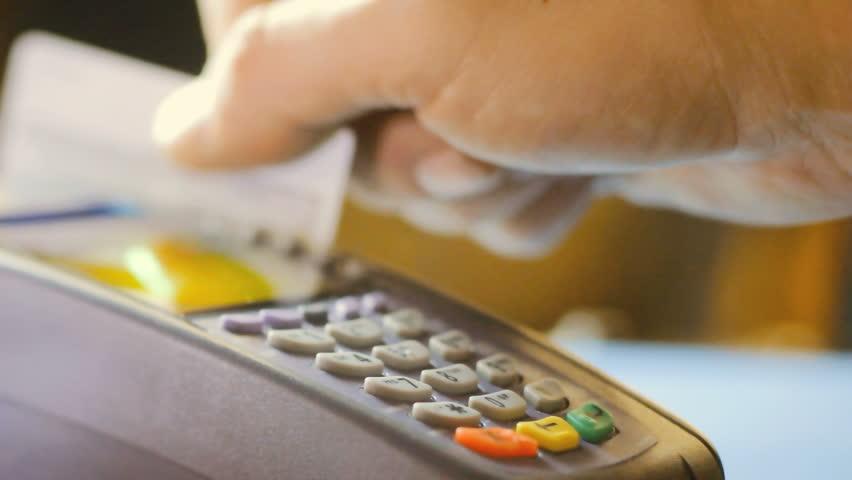 Credit card swipe through terminal machine    Shutterstock HD Video #9678662