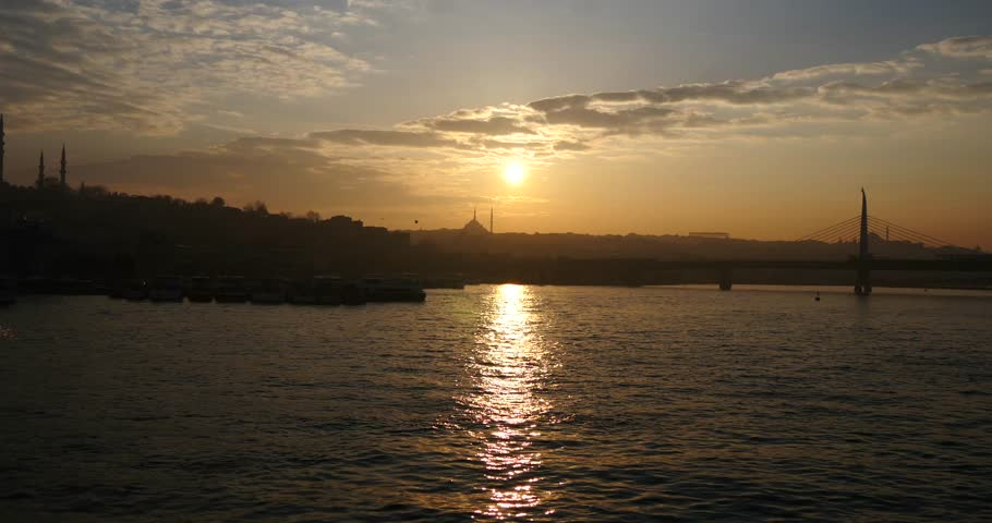 ISTANBUL - MARCH 30: Beautiful sunset in Istanbul over the Golden Horn with mosques in the background 4K 30, 2015 in Istanbul, Turkey. - 4K stock footage clip