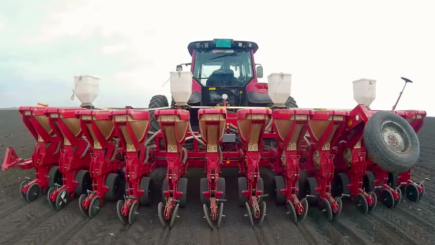 Spring sowing of corn ; Sowing of corn with modern agriculture mechanization,video clip | Shutterstock HD Video #9701441