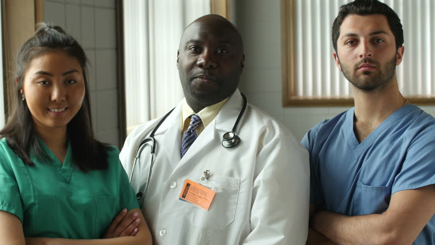 Diverse Medical team looking at camera, pleased and confident