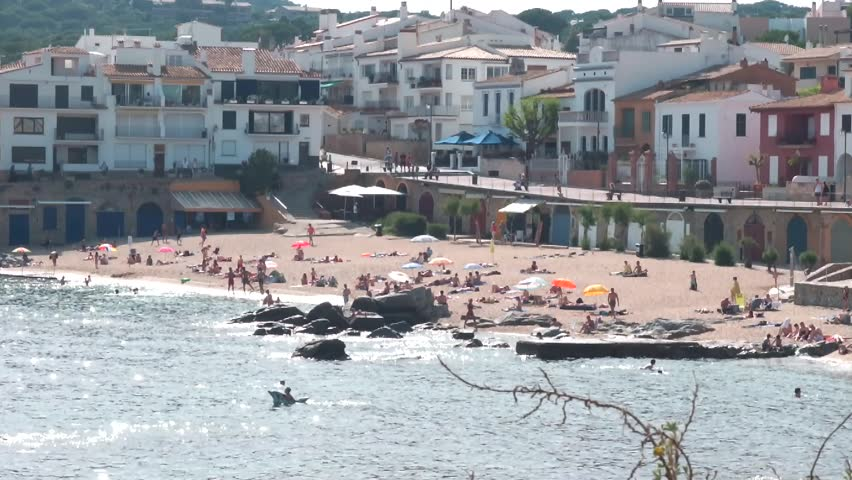 people relax and bathe on the Spanish coast
