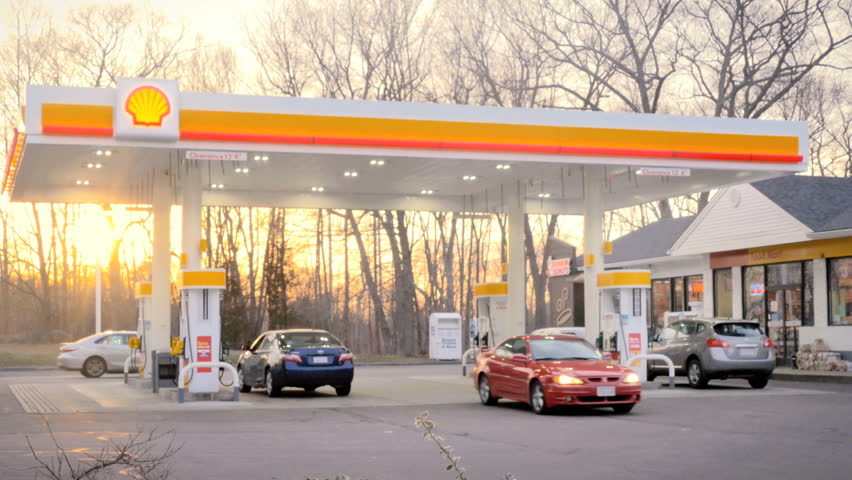 ATTLEBORO, MA - APRIL 27, 2015: Shell gas station open for business on April 27, 2015. 137.78 billion gallons of gasoline were consumed in the United States in 2014, a daily average of 375 million gallons.