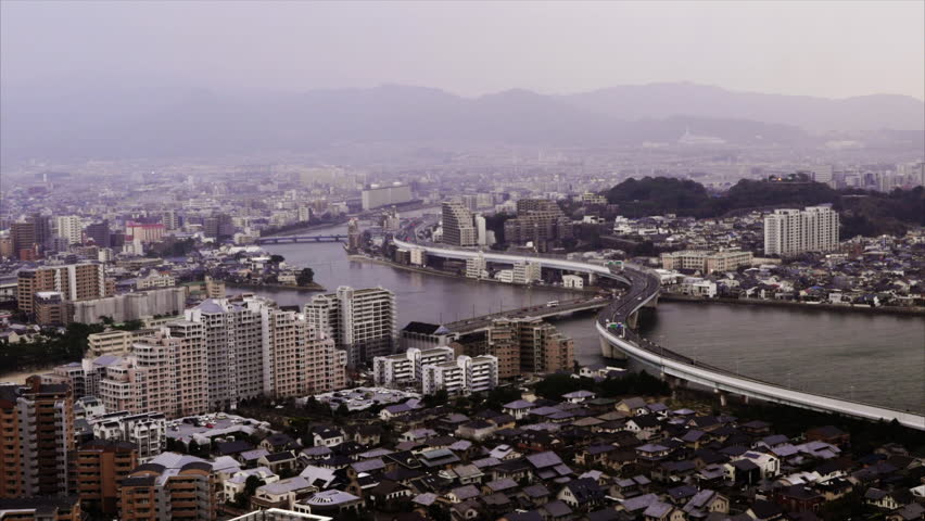 Japanese city, freeway and river, top view, medium, dusk, March 2015. - HD stock footage clip