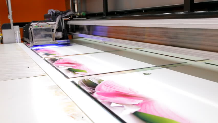 Large format UV ink jet printer in action - HD stock footage clip
