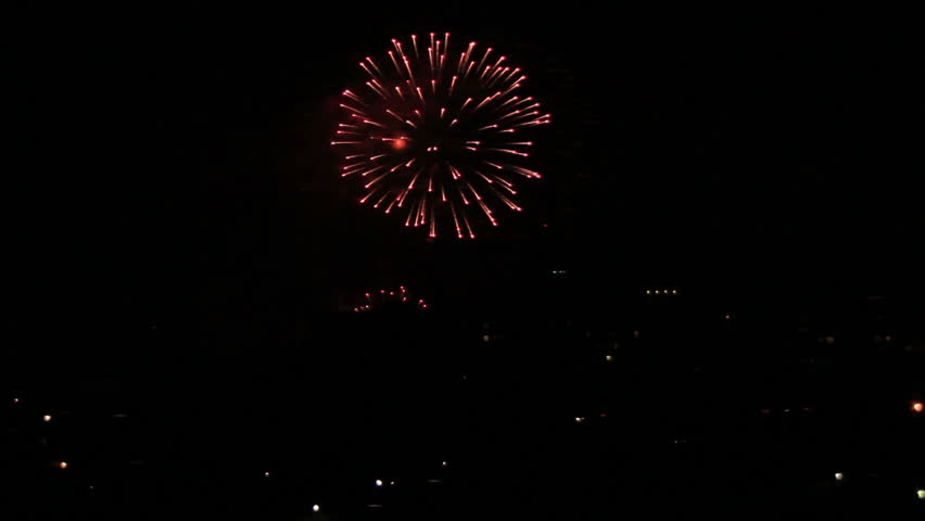 Holiday firework in town night sky | Shutterstock HD Video #9838115