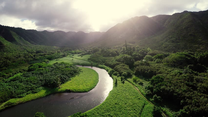 Amazing Lighting Aerial Flight Over Hawaii Rainforest Tropical River Valley #9841571