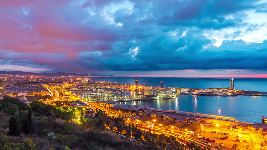 Aerial view timelapse (time lapse, time-lapse) of Barcelona city sunrise from Montjuic mountain mirador, Spain. September 2013. | Shutterstock HD Video #9841625