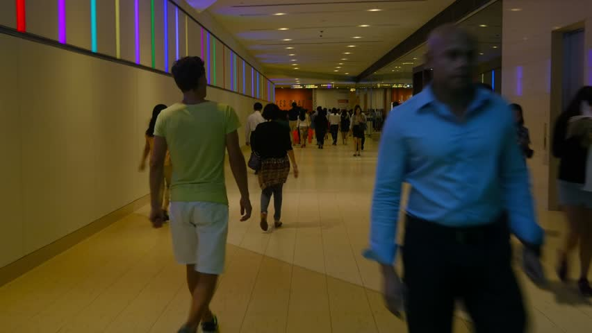 SINGAPORE - CIRCA APRIL 2015: POV, people, commuters walking in underground passage, steadicam. - 4K stock footage clip