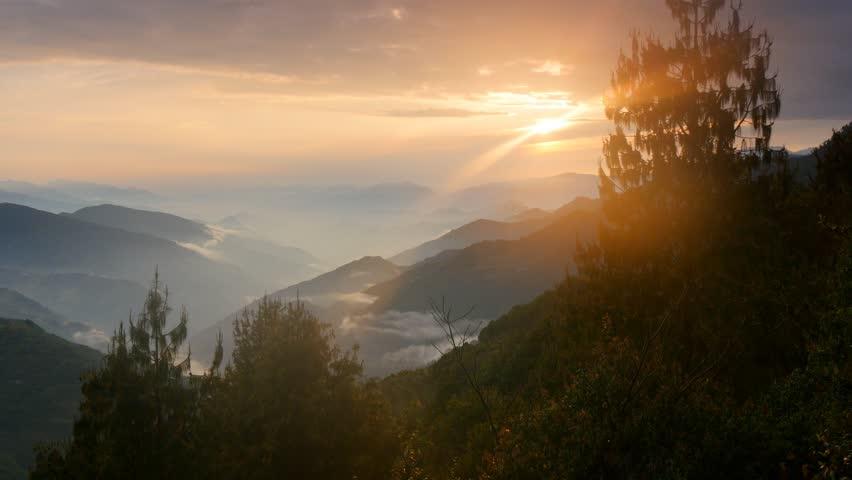 Foggy Himalayas mountains at sunset lights. Nepal, Langtang national park. UHD, 4K   Shutterstock HD Video #9866429
