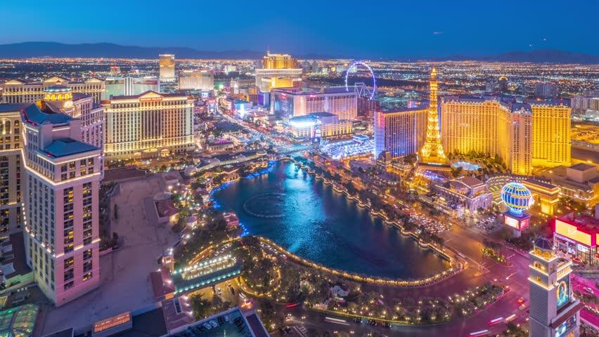 LAS VEGAS - April 2015: Aerial view of Las Vegas Strip skyline as sunset transitions to night over illuminated city. 4K UHD Timelapse.   Shutterstock HD Video #9876788