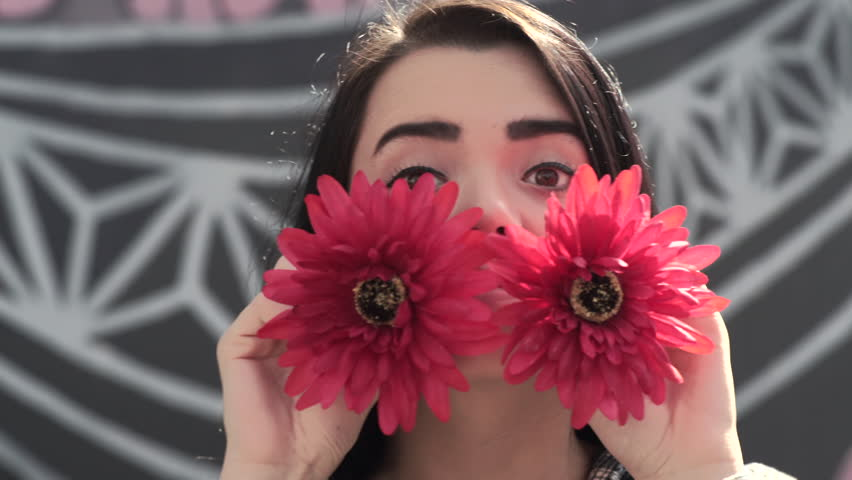 Closeup Of Mixed Race Teen Girl, She Covers Her Eyes With Flowers, Makes Funny Faces And Peaks Out (4K)