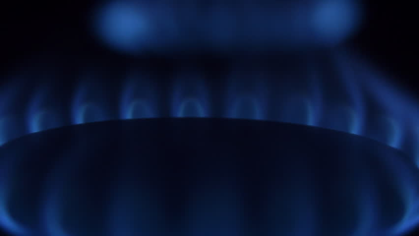 Natural gas burn in stove burner. Rotating gas burner. The camera moves around. Several gas burners in the frame. Closeup - HD stock video clip
