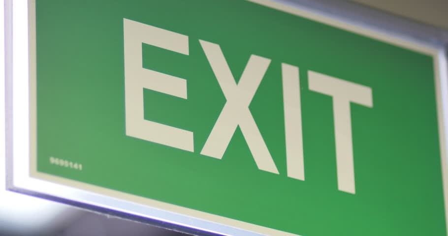 Footage of an exit sign-the shot moves from right to left