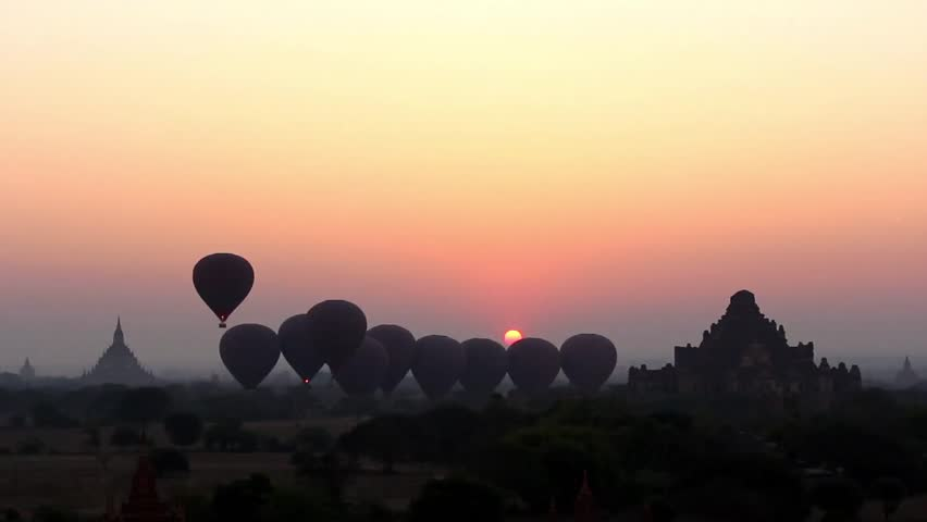 Hot Air Balloons go up in Sunrise in Bagan, Myanmar (Burma). Magic Sunrise with Air Balloons and Spectacular Colors