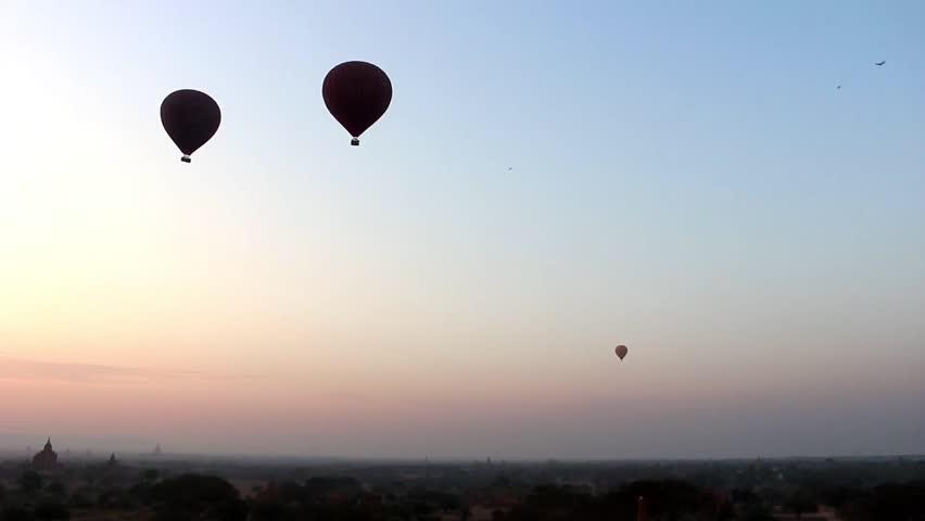 Hot Air Balloons in the Air in Sunrise in Bagan, Myanmar (Burma).