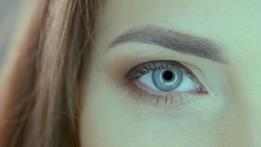 CLOSE UP: Big Brown Eyes Looking Directly At Camera